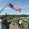 James Neiss/staff photographerNiagara Falls, NY - Tourists take vacation photos with the World Memorial Flag behind them at Prospect Point in Niagara Falls State Park. The World Memorial is a tribute to public safety personnel, the armed forces and the families of the fallen on September 11, 2001.