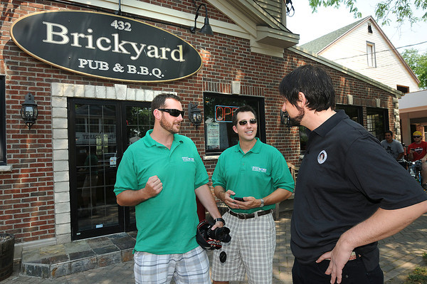 "James Neiss/staff photographerNiagara Falls, NY - Travel bloggers Brian Cox and Mike Shubic talk to The Brickyard General Manager Steve Matthews before heading in to sample the food. Cox and fellow travel blogger Mike Shubic are traveling the country as part of the ""Best of the Road"" contest sponsored by Rand McNally and USA Today. The two writers put their taste buds to the test visiting local eating establishments in Lewiston on Thursday."