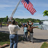 James Neiss/staff photographerNiagara Falls, NY - The Thomas family from San Diago, California, from left, Alonza, his wife Farideh, and their children Chris, 18 and Alex, 13, take vacation photos with the World Memorial Flag behind them at Prospect Point in Niagara Falls State Park. The World Memorial is a tribute to public safety personnel, the armed forces and the families of the fallen on September 11, 2001.