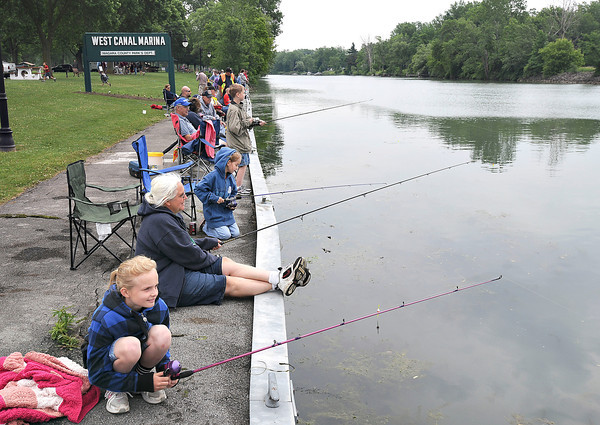 James Neiss/staff photographerPendleton, NY - Kiya Smith, 10, left, and her sister Aora Smith, 8, enjoy fishing with their grandmother Pam Pollow, center, during the Pendleton Lion's Club Kids Fishing Derby at the West Canal Marina on Saturday.