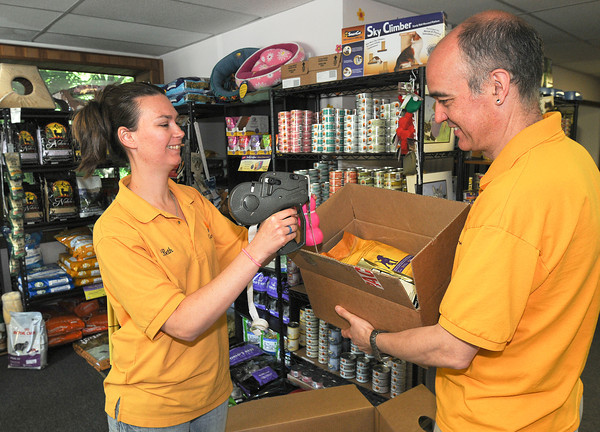 James Neiss/staff photographerLewiston, NY - Assistant Manager Beth Skellen and Manager Andrew Bell put new stock on the shelves. Grandpaws Pet Emporium moved from Portage Road to Center Street on May 1.