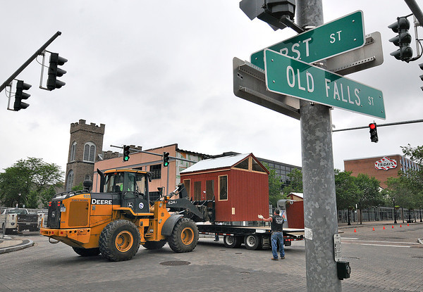 James Neiss/staff photographerNiagara Falls, NY - City workers set up the Holiday Market stalls on Old Falls Street that are being repurposed for the June 15, Wallenda Walk activities downtown.