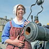 James Neiss/staff photographerYoungstown, NY - Old Fort Niagara employee Kaitlyn Bishara portrays Betsy Doyle loading a cannon for members of the 1st US Artillery.