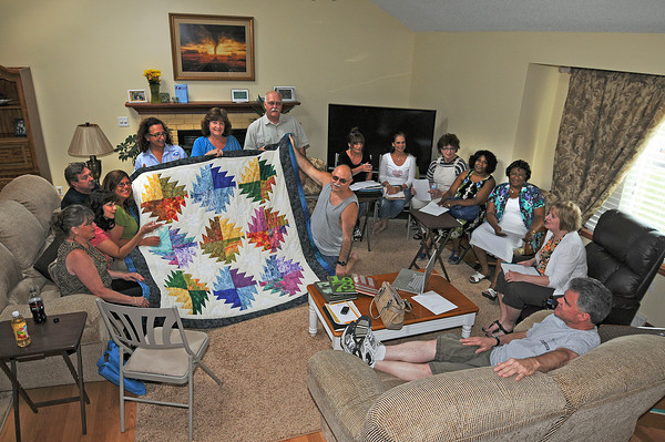 James Neiss/staff photographerTown of Niagara, NY - Members of the Class of 1972 check out a handmade quilt that will be auctioned off at their reunion. Class of 1972 members from Niagara Falls, LaSalle Senior, Trott Vocational, Madonna and Bishop Duffy High Schools, plan a combined 40th reunion featuring 2 days of events around Niagara Falls on June 29 and 30.