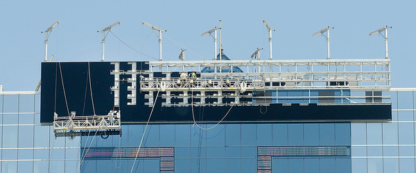 James Neiss/staff photographerNiagara Falls, NY - Workers build the new video signboard at the Seneca Niagara Casino and Hotel. The Seneca Gaming Corporation announced that a 108-foot wide, 20-foot tall high-definition LED video sign will be built on top of the Seneca Niagara Casino Hotel facing Canada. The $1.9 Million LED sign will be constructed using 140 giant LED panels like this, and should be completed later this month.