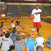 James Neiss/staff photographerLewiston, NY - Hall of Famer Calvin Murphy told his students that you have to start with the basics, during a Niagara University alumni weekend basketball clinic.