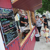 James Neiss/staff photographerNiagara Falls, NY - There's hot and cold drinks galore at the Kornerstone Coffee booth on the corner of Rainbow Boulevard and Old Falls Street. The former Holiday Market booths are being repurposed for use this summer. Enjoying a selection of drinks made by Manager Anthony Atti, left, are Janet Browers and her daughter Emma, 4 and son Devin Starr, 13.