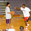 James Neiss/staff photographerLewiston, NY - Hall of Famer Calvin Murphy challenges Mario Wright, 13 of Grand Island, to guard the ball from him during a Niagara University alumni weekend basketball clinic.