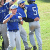 James Neiss/staff photographerNiagara Falls, NY - Grand Island baseball players celebrate their first run by #5 Kevin Dobson during Far West Regional Playoff Game against Honeyoye Falls-Lima at Sal Maglie Stadium.