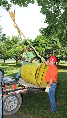 James Neiss/staff photographerNiagara Falls, NY - O'Connell Electric General Foreman Randy Fletcher and driver Scott Moran unload a Shoulder Block, part of the support system for Nik Wallenda's cable.