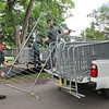 James Neiss/staff photographerNiagara Falls, NY - New York State Parks workers Fred Azzarelli, left, and Nick Kasperzak get ready to put up barricades in preparation for the crowds on Goat Island Friday.