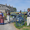 James Neiss/staff photographerYoungstown, NY - Old Fort Niagara employee Kaitlyn Bishara portrays Betsy Doyle loading a cannon for members of the 1st US Artillery portrayed by, from left, Ryan Clark, Alan Eimiller and Nick D'Amuro.