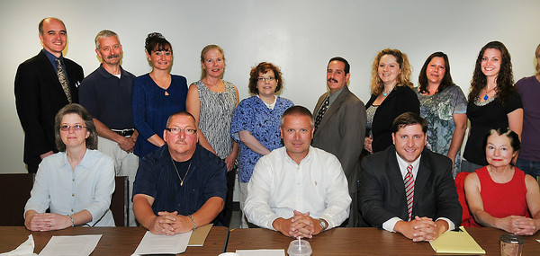 James Neiss/staff photographerNiagara Falls, NY - Newly elected Niagara County board members from left, back row: Andrew Bell, Larry Eggert, Michelle Madigan, AnnLouise Carosella, Christen Strobel, Bryan Parish, Pamela Bruns, Karen Karsten, Rachel Stepien. In front are: Kathy Lamont, David Bower, David Urban, Bob Richardson and Susan Persico. Missing is Stephanie Ortel.