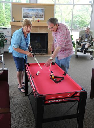 James Neiss/staff photographerNiagara Falls, NY - Complete Senior Care program of HANCI client Dalia Desimone learns how to play miniature pool from volunteer Edward Alfano.