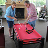 James Neiss/staff photographerNiagara Falls, NY - Complete Senior Care program of HANCI client Dalia Desimone learns how to play miniature pool from volunteer Edward Alfano.