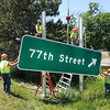 James Neiss/staff photographerNiagara Falls, NY - Contractors with Elderlee, Inc., replace outdated signs along the La Salle Expressway, A representative, said the signs have lost their reflective ability and that the state is now using metric based hardware.