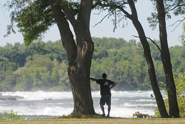 James Neiss/staff photographerNiagara Falls, NY - Taking in the View: Tourist Ronald Brown of Scottsville, NY, stopped to take in the majestic views of the mighty Niagara River and the upper rapids from Goat Island at Niagara Falls State Park.