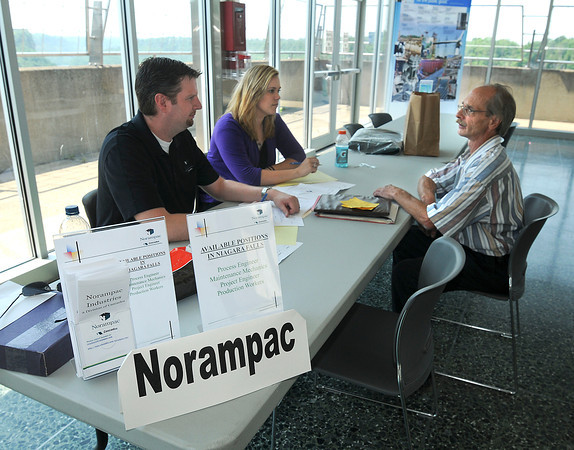 "James Neiss/staff photographerLewiston, NY - Norampac HR Generalist Mark Wozniak and HR Intern Jessica Griffin interview Phillip Banasiak of Lockport, who's been unemployed for more than 6 months. The Niagara USA Chamber of Commerce and the New York State Department of Labor held a Mini Targeted Job Fair at the Niagara Power Vista Visitors Center. A total of 10 business were scheduled to participate with the purpose of matching ""difficult to fill"" positions with job-seekers."