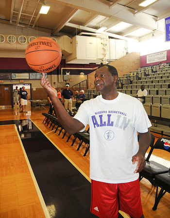 James Neiss/staff photographerLewiston, NY - Hall of Famer Calvin Murphy shows off his ball handling magic before a Niagara University alumni weekend basketball clinic for children.