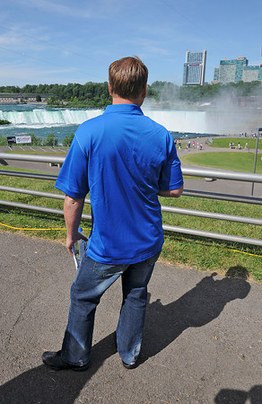 James Neiss/staff photographerNiagara Falls, NY - Wire-walker Nik Wallenda takes a moment to take in his setting for Friday nights walk from Terrapin Point on Goat Island to Niagara Falls, Ontario.