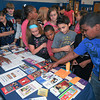 James Neiss/staff photographerNiagara Falls, NY - Students at Niagara Street Elementary look at brochures from many of the health services offered at Niagara Falls Memorial Medical during the schools Health and Resource Fair.