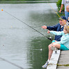 James Neiss/staff photographerPendleton, NY - Gene Boyer of Pendleton gives his daughter Lana, 8, a lesson on how to hold a fishing rod during the Pendleton Lion's Club Kids Fishing Derby at the West Canal Marina on Saturday.