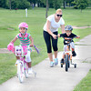 James Neiss/staff photographerNiagara Falls, NY - Training Time: Little Jerriana Davis 4, left, and brother Calvin, 3, seem determined to lose their training wheels during a bicycle riding excursion to Hyde Park with their mother Jerrica Davis.