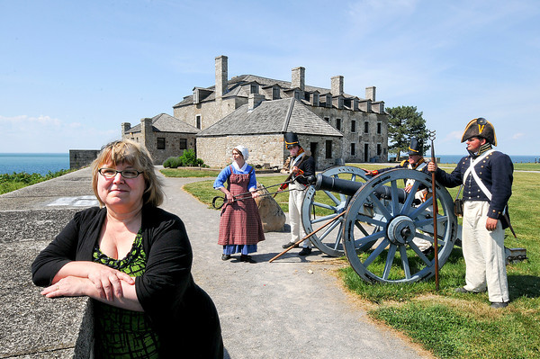 "James Neiss/staff photographerYoungstown, NY - Old Fort Niagara employee Kaitlyn Bishara portrays Betsy Doyle loading a cannon for members of the 1st US Artillery portrayed by, from left, Ryan Clark, Alan Eimiller and Nick D'Amuro. Niagara County Historian Kate Emerson, left, wrote a paper ""An Industrious and Worthy Woman: The Chronicle of Betsy/Mary Doyle and Her Husband Andrew."""