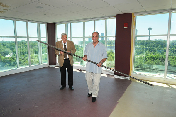 James Neiss/staff photographerNiagara Falls, NY - One Niagara Managing Partner Paul Grenga, right, and President Tony Farina are preparing for their own balancing act of fun and entertainment as they prepare the top floor so guests can view a portion of the Nik Wallenda high-wire walk on Friday.