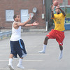 James Neiss/staff photographerNiagara Falls, NY - Joshca Walker was a little late as Quentin Smith, right, intercepts a pass during a game of parking lot football off Main Street.