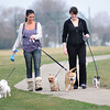 James Neiss/staff photographerNiagara Falls, NY - Best friends Danielle Jayroe, left and Jennifer Hendrix take advantage of the spring like weather on the last day of winter for a walk at Hyde Park with their dogs, from left, Chichi, Kingston, Wizzer and Rocco. Spring officially arrives Tuesday, March 20th, 7:04am est.