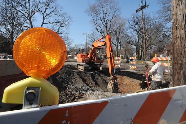 James Neiss/staff photographerNiagara Falls, NY - Verizon workers dig a trench in the middle of Maple Avenue on the corner of Lewiston Road. Residence are complaining that the Lewiston Road project is taking too long.