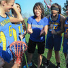 James Neiss/staff photographerSanborn, NY - Niagara County Community College Woman's Lacrosse coach Kim Abrams revs up her team before practice.