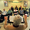 James Neiss/staff photographerLewiston, NY - The Lewiston Larks break into song under the direction of Ellen Beggs-Davidson during practice at the Lewiston Senior Center.
