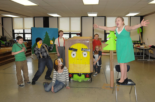 """James Neiss/staff photographerSanborn, NY - Edward Town Middle School students, from left, Dylan Smith, Kyle Otminski, Mara Scive, Trevor Cannon, Jacob Ambrosia, Jordan Hiscock and Hailey Faron practice for the Odyssey of the Mind competition this Saturday in Binghamton. The name of their presentation is """"Ooh Motion Al."""""""