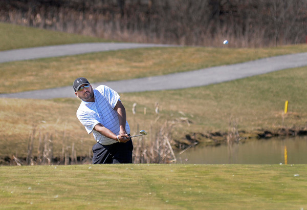 James Neiss/staff photographerLewiston, NY -  Parm Atwal of Wilson hits his ball onto the green during a round of golf at the Seneca Hickory Stick Golf Course. The mild winter weather allowed the golf course to open early this season.