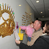 James Neiss/staff photographerLewiston, NY - The Mahoney family, from left, Kaley, 28 mos., Robert and Lynn, all of Wilson, check off Easter Eggs they found while taking part in the Power Vista Easter Egg Scavenger Hunt during Eggstraviganza at The New York Power Authority's Niagara Power Project Power Vista.