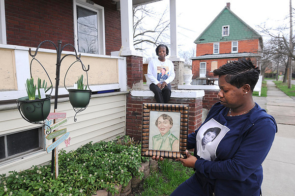 James Neiss/staff photographerNiagara Falls, NY -  Rene Williams and her daughter Shawntel Williams keep a manicured garden at their Beech Avenue home in honor of her mother/grandmother Zenobia Williams who was struck and killed by a hit and run driver. The family held a fundraiser and is offering a reward for information that leads to a conviction of the killer.