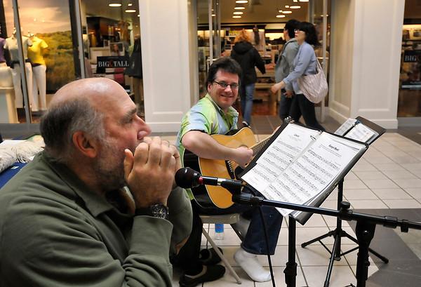 James Neiss/staff photographerNiagara Falls, NY - John Dziewit, left, and Joe Mombrea of the band Ryleigh, play for patrons during Irish Heritage Day at the Fashion Outlets on Saturday.