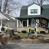 James Neiss/staff photographerNiagara Falls, NY - City crews tidy up after cutting up a tree that fell on a Niagara Avenue home, crushing the porch because of high winds in the area.