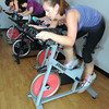 James Neiss/staff photographerLewiston, NY - Gina Farrelly of Lewiston, puts it into high gear during a spinning class where the cyclists are participating in a Tour de France theme cycling project at Niagara Health & Fitness facility in Lewiston.