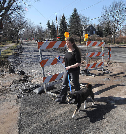 James Neiss/staff photographerNiagara Falls, NY - Gina Gigliotti takes her dog Sobe for a walk in front of her Lewiston Road home. Gigliotti, said she's had enough of the road work in her neighborhood.