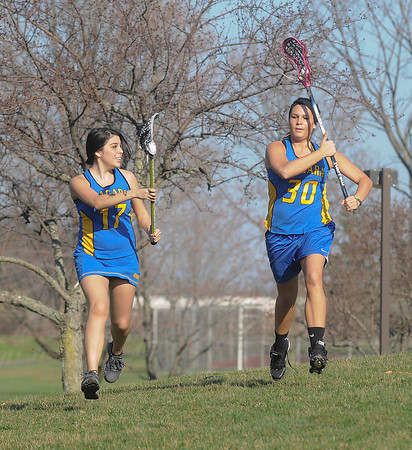 James Neiss/staff photographerSanborn, NY - Paige Printup of the Town of Niagara, left, is right on the heels of Lynn Keohane, of Amherst, during drills at the Niagara County Community College Woman's Lacrosse practice.