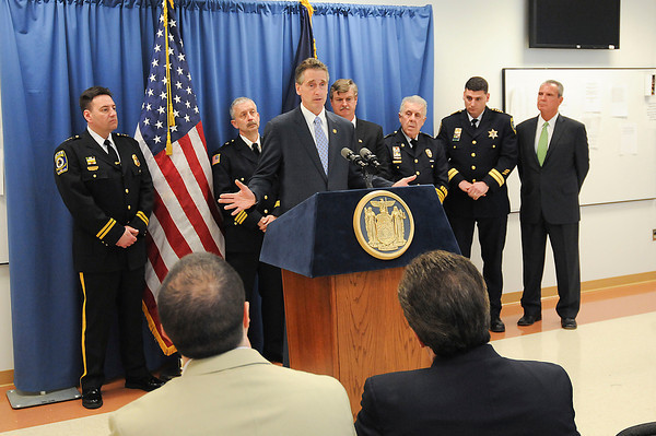 James Neiss/staff photographerNiagara Falls, NY - Niagara County's top cops joined New York State Lieutenant Governor Robert J. Duffy to hail Governor Cuomo's recently passed law that expands the New York State DNA Databank during a press conference at the Niagara Falls Public Safety Building. Behind the Lt. Governor from left are, Town of Niagara Police Chief Jim Suitor, Lockport Police Chief Lawrence Eggert, Mayor Paul Dyster, Niagara Falls Police Superintendent John Chella, Niagara County Sheriff James Voutour and District Attorney Mike Violante.