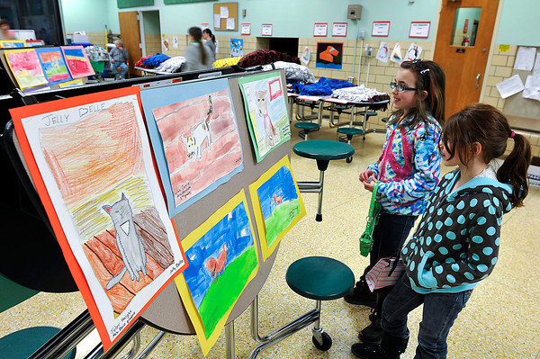 James Neiss/staff photographerNiagara Falls, NY - Gianna Dorato, 9, left, and Jillian Brierley, 8, look at the animal artwork up for auction at the sixth annual Save-A-Pet Art Gallery show and fund raiser for the local chapter of the Save-A-Pet organization at the Lewiston - Porter Intermediate Education Center.