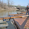 James Neiss/staff photographerNiagara Falls, NY - Craig Bates, left, helps his friend Chris Cheers install some floating docks on Cayuga Creek behind his parents Point Avenue home. Cheers, said they were installing the docks early this year because of the incredibly mild weather.