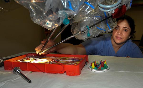 James Neiss/staff photographerNiagara Falls, NY - Interim Chief of Robotic Surgery at Niagara Falls Memorial Medical Center Donna Azam Feldman, M.D., shows off the operating hands of the hospitals new robotic da Vinci Si Surgical System.