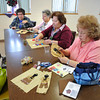 James Neiss/staff photographerNiagara Falls, NY - Members of the Native American Elders Group, from left, Jean Carpenter, Virginia Silversmith, Verona Wable and Brenda Bradley work on a Native American Quilt with Indian figures at the John A. Duke Niagara Falls Senior Citizen Center.