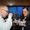 James Neiss/staff photographerNiagara Falls, NY - Ryan U'Ren and Lauren Cerrone enjoy a tasty dish during this years SEAsonings fund raiser at the Aquarium of Niagara.