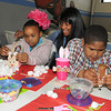 James Neiss/staff photographerNiagara Falls, NY - It was cotton balls for cottontails as tutor Mary Tillman, center, works with Nikita Thomas, 8, left and Rashan Vincent, 9, right, on an Easter craft project at the Niagara Falls Boy's & Girl's Club on 17th Street.